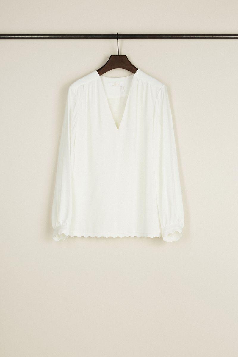 Weiße Bluse mit Muschelsäumen Weiß