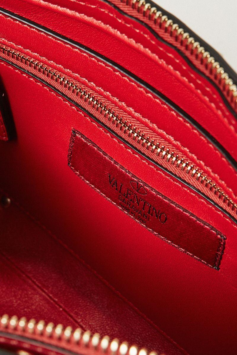 Clutch 'Spikes' mit Nietenbesatz Rot