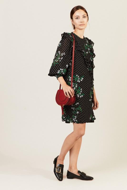 Gepunktetes Kleid mit floralem Print Schwarz