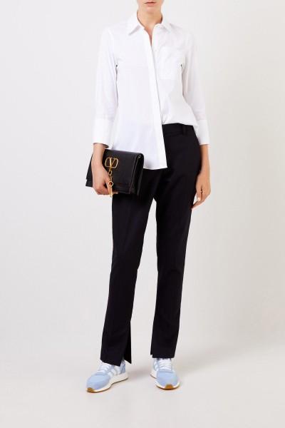 Klassische Bluse mit breiten Manschette Weiß
