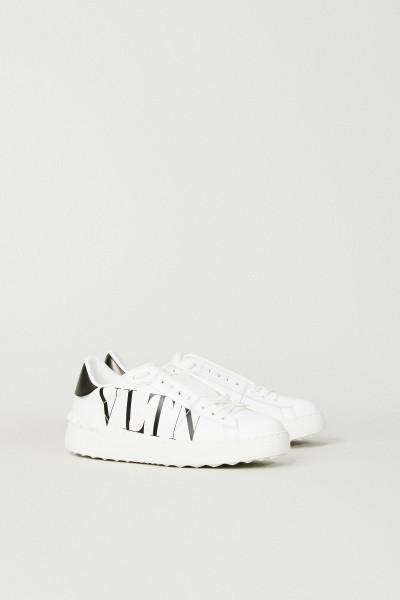 Sneaker mit Logo-Schriftzug und Nieten Weiß/Schwarz